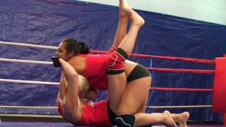 Sporty and busty brunette Lioness wrestles on the boxing ring