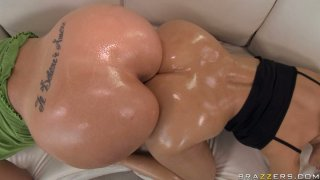 Two oiled shining butts touching each other