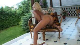 Frisky blonde babe Gina Pearl stretching her twat with huge dildo